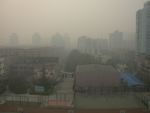 Smog obscures the view of anything more than one block away from my Beijing balcony.