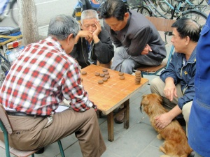 A sidewalk game of - Chinese checkers?