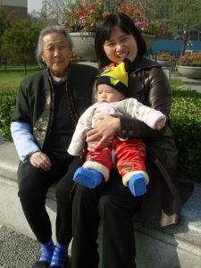 A China Daily employee with her daughter and her grandmother